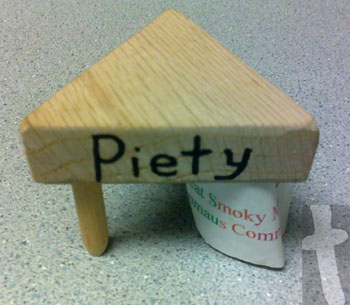 1 of the three sides reads piety- Was an Agape Gift from my Walk to Emmaus #32