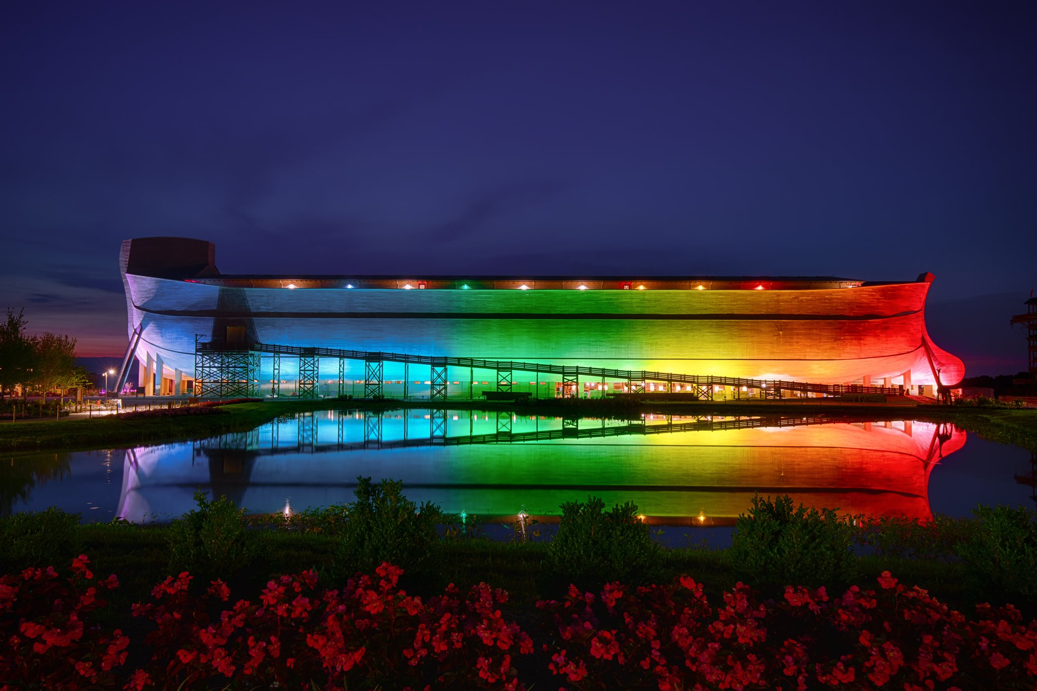 The Ark Encounter Lit up in Rainbow Colors to show that the rainbow belongs to God!