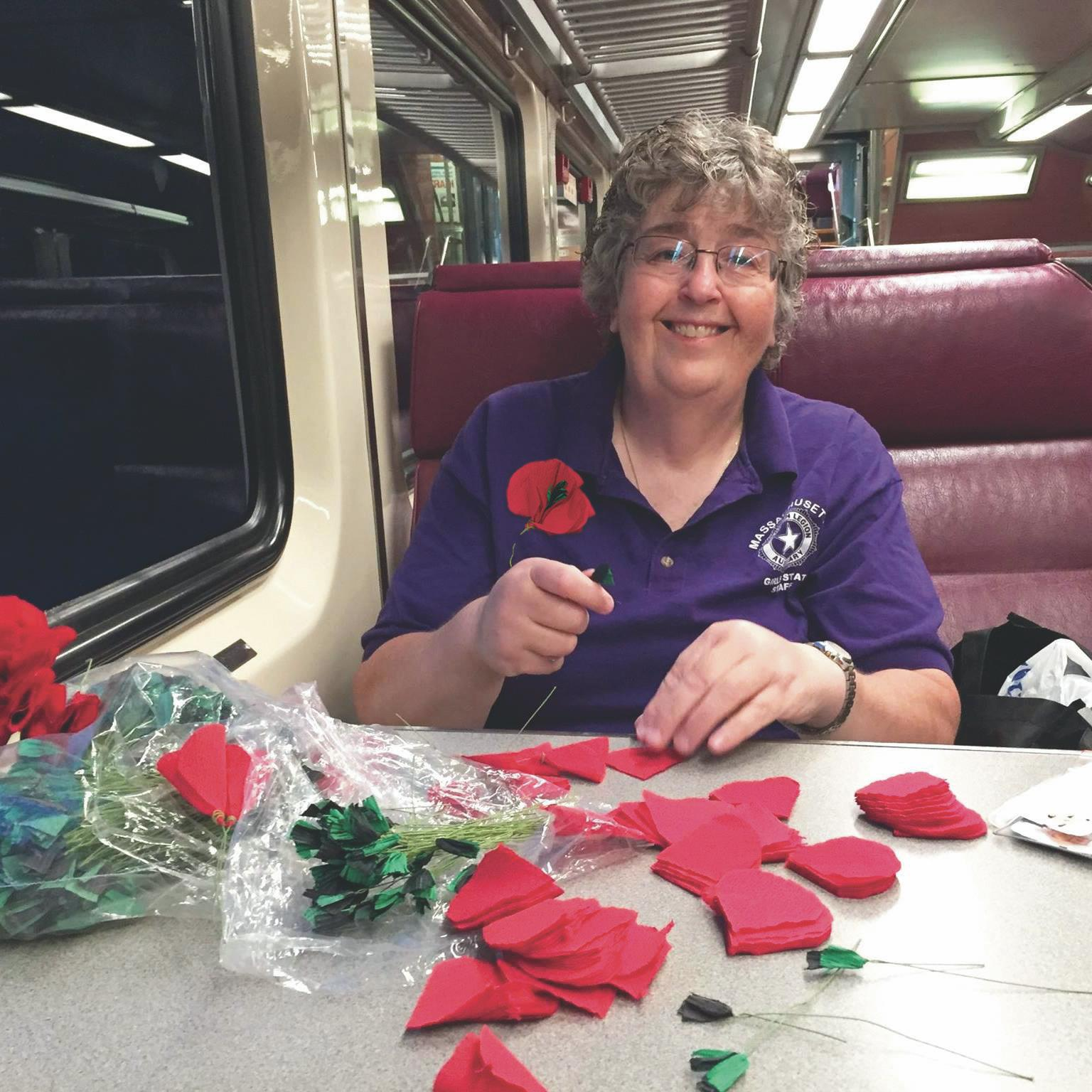 Wearing a poppy supports veterans   Pictured is Ann Fournier making the poppy flowers on the train.   Picture compliments of BrandPoint