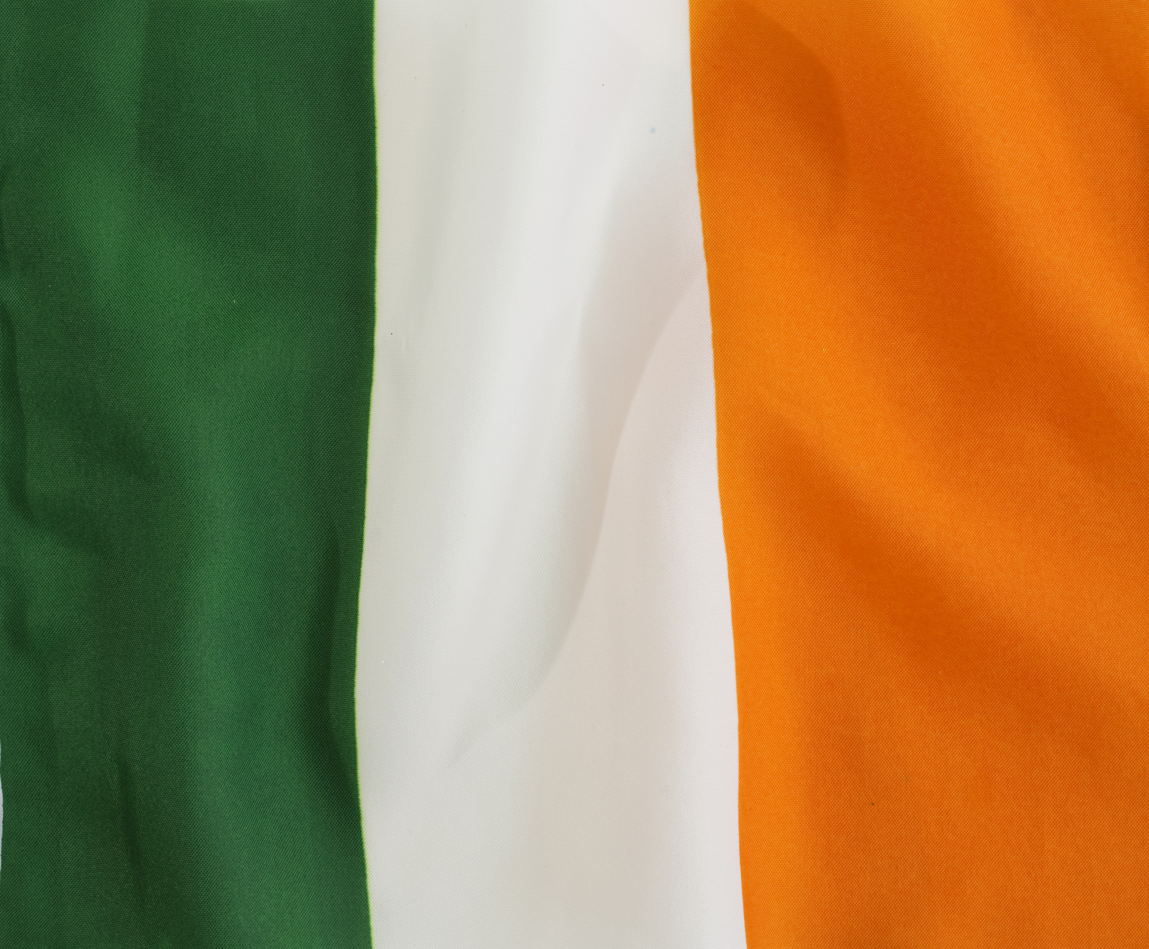 The Irish Flag - Many establishments display the familiar Irish tricolor flag on St. Patrick's Day, and paradegoers may even wave miniature versions of this significant symbol in support of those marching. This instantly recognizable flag has a rich history. Equal parts green, white and orange, the flag was designed to foster peace in the country that had experienced considerable turmoil due to the divide between the country's Protestant and Catholic residents.